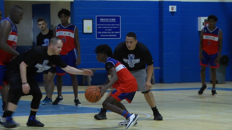 It was OPD versus the Ocala Trilogy Youth team at the first annual 'Hoops and Badges' event...