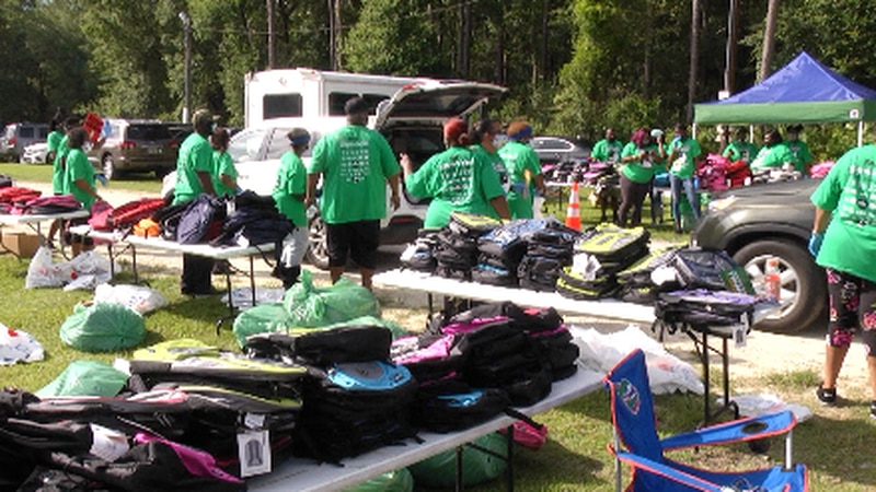 Parents and students received free backpacks and school supplies as organizers hold this event...