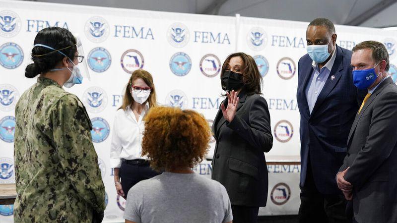 Vice President Kamala Harris talks to Navy Hospitalman Apprentice Vianni Torres, left and High...