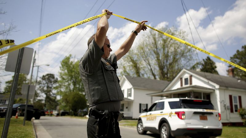 Law enforcement investigate the scene of a shooting, Wednesday, April 21, 2021 in Elizabeth...