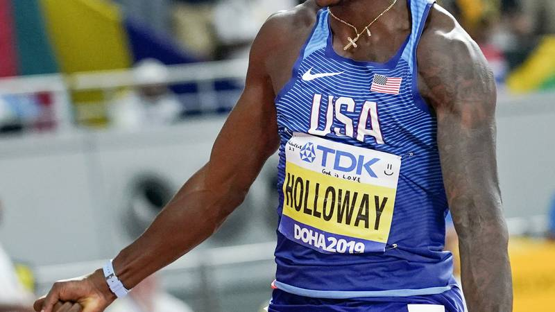 Grant Holloway, of the United States, wins the the men's 110 meter hurdles final at the World...