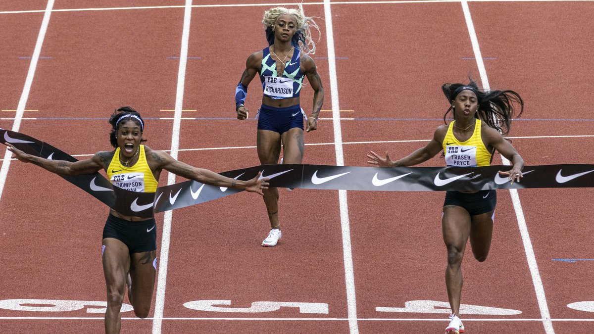 Jamaica's Elaine Thompson-Herah, left, wins the 100 meters, as American track and field...