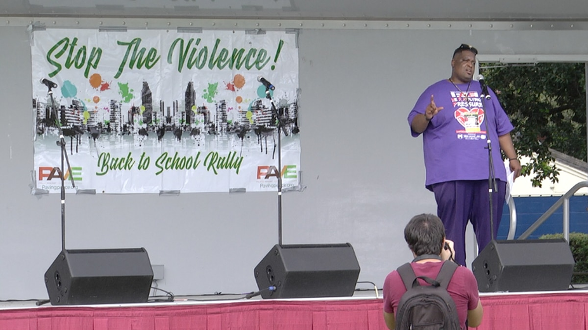 """Hundreds attend drive-through """"Stop the Violence Back to School Rally"""""""