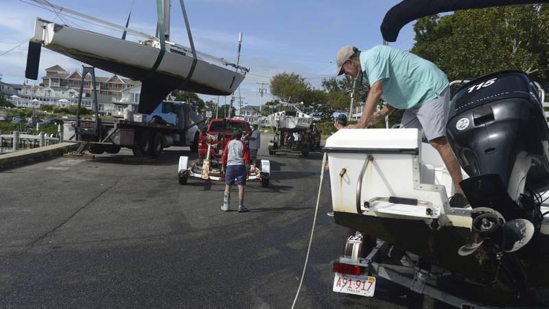 Baxter Crane Company hauls one of the Hyannis Yacht Club J22 sailboats onto a trailer at the...