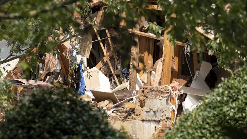 Damage to an apartment building is seen following an explosion, Sunday, Sept. 12, 2021, in...