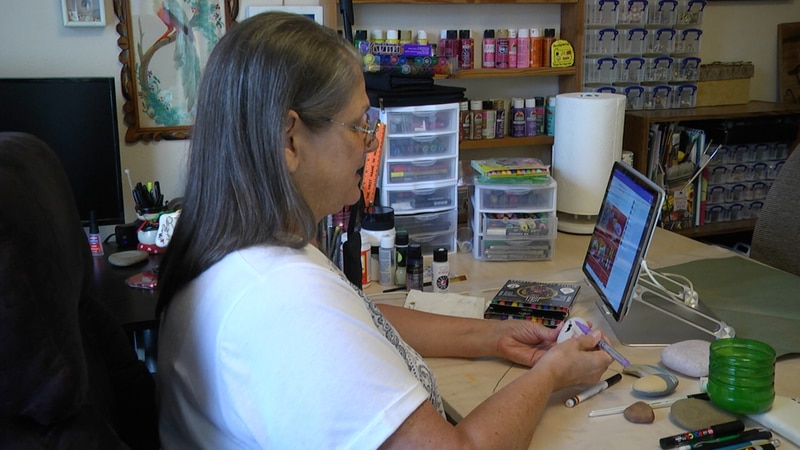 Regina Huffman is tackling this epidemic, by painting rocks. She explained the design of her...