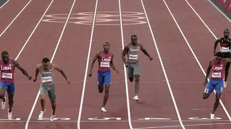 Andre De Grasse, of Canada races to win the gold medal ahead of Kenneth Bednarek, of United...