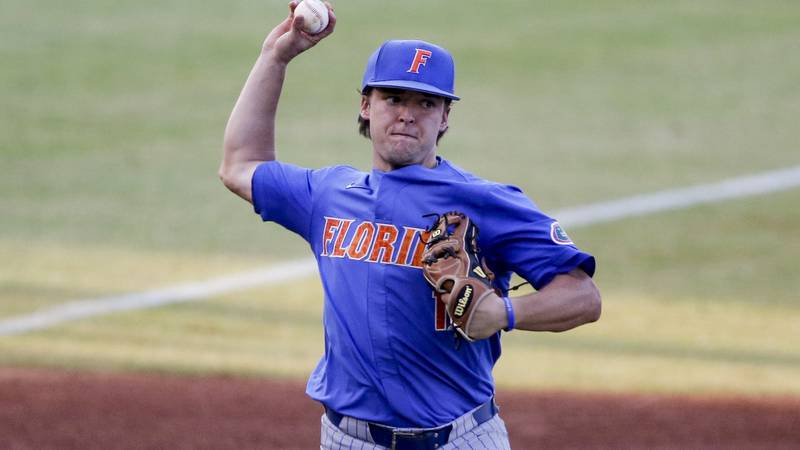 Florida infielder Nathan Hickey (11) throws to first for the out against Alabama in the eighth...