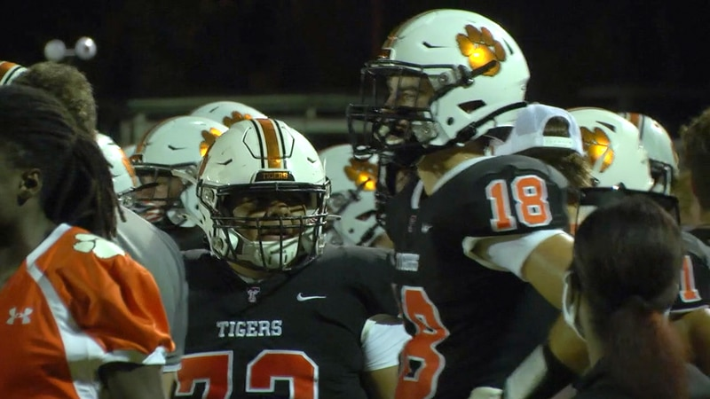 Trenton football players huddle up during a game in 2020.