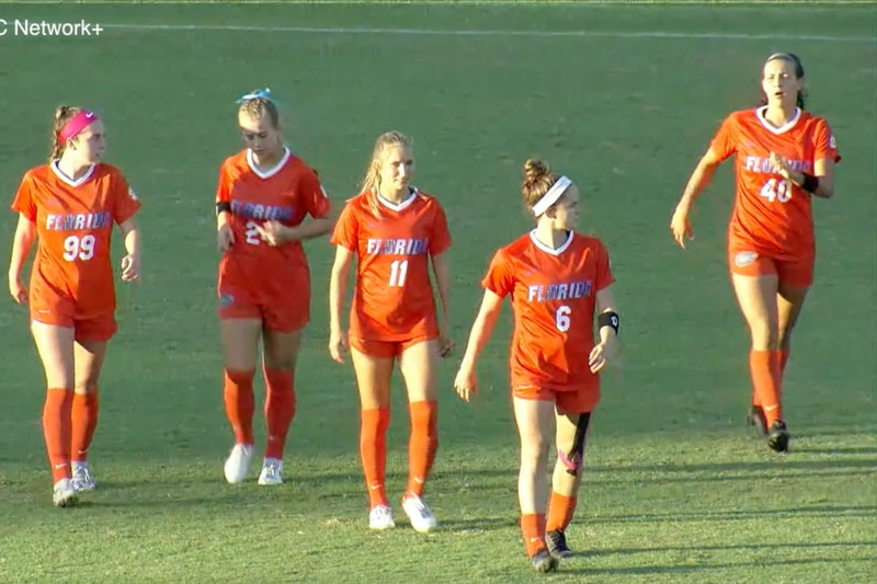Gator soccer walks out to midfield before kickoff against Mississippi State.
