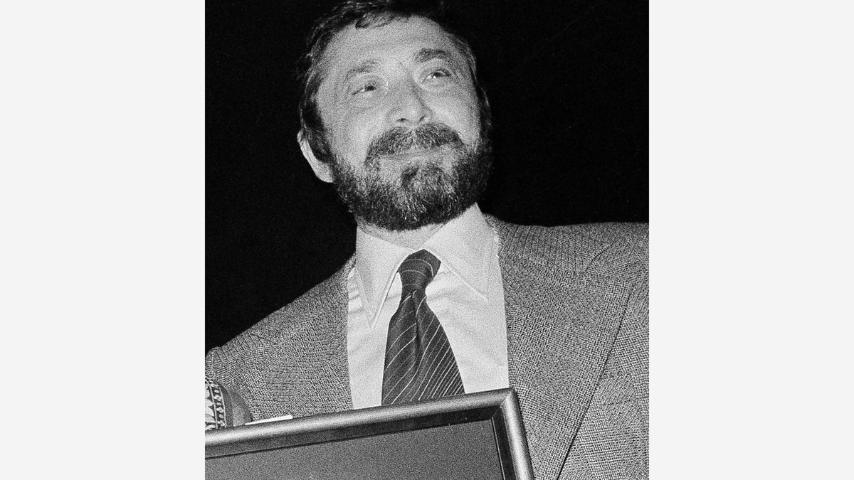 Walter Yetnikoff, president of CBS Records, presents gold records in New York on Jan. 17, 1978....