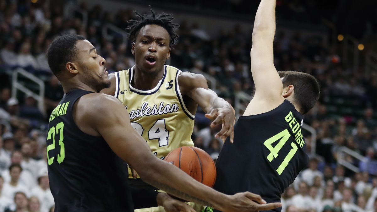 Charleston Southern guard Phlandrous Fleming Jr. (24) is defended by Michigan State forward...