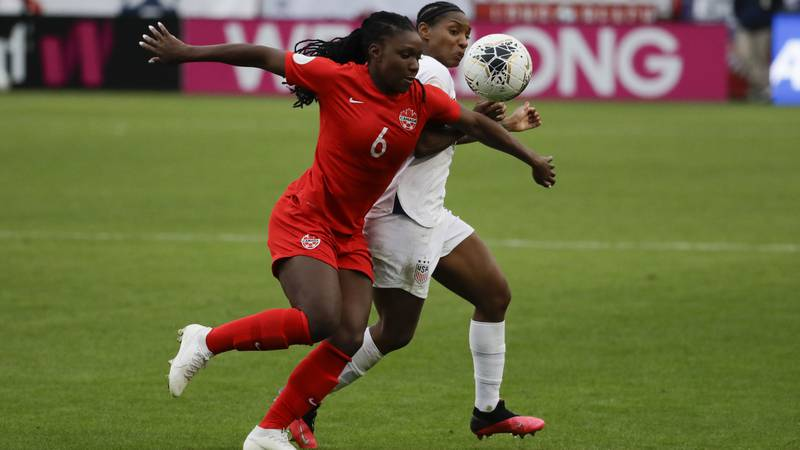 Canada forward Deanne Rose plays against the United States during the second half of a CONCACAF...