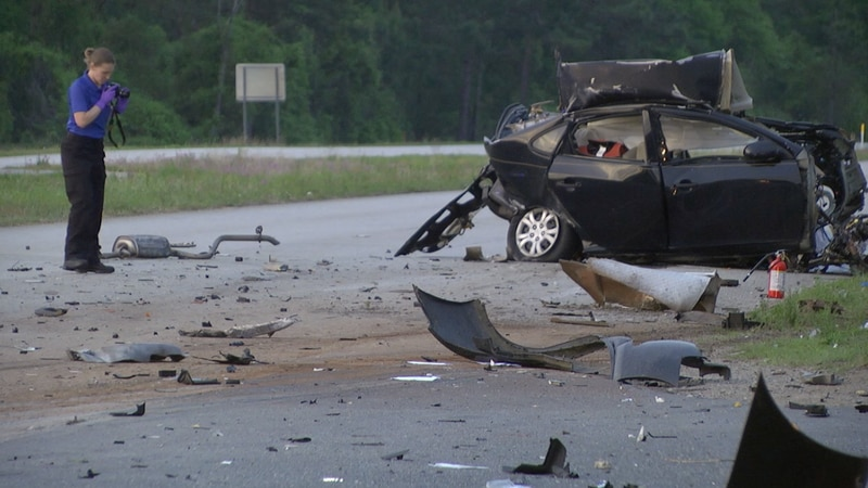Woman dies after crashing into semi-truck