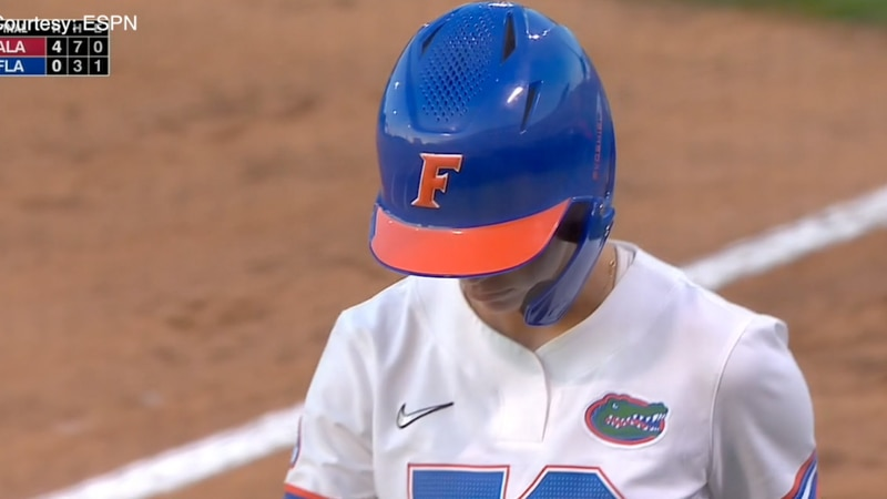 Sarah Longley looks down after in dismay after the Gators lost the SEC championship game to...