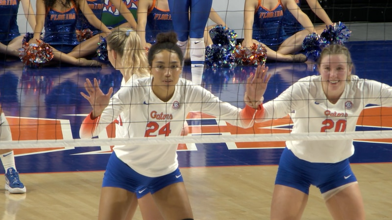 Florida volleyball players Lauren Forte and Thayer Hall prepare for a serve against Texas A&M...