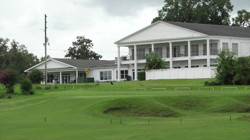 The beautiful clubhouse at Ocala National Golf Club frames the 18th green.
