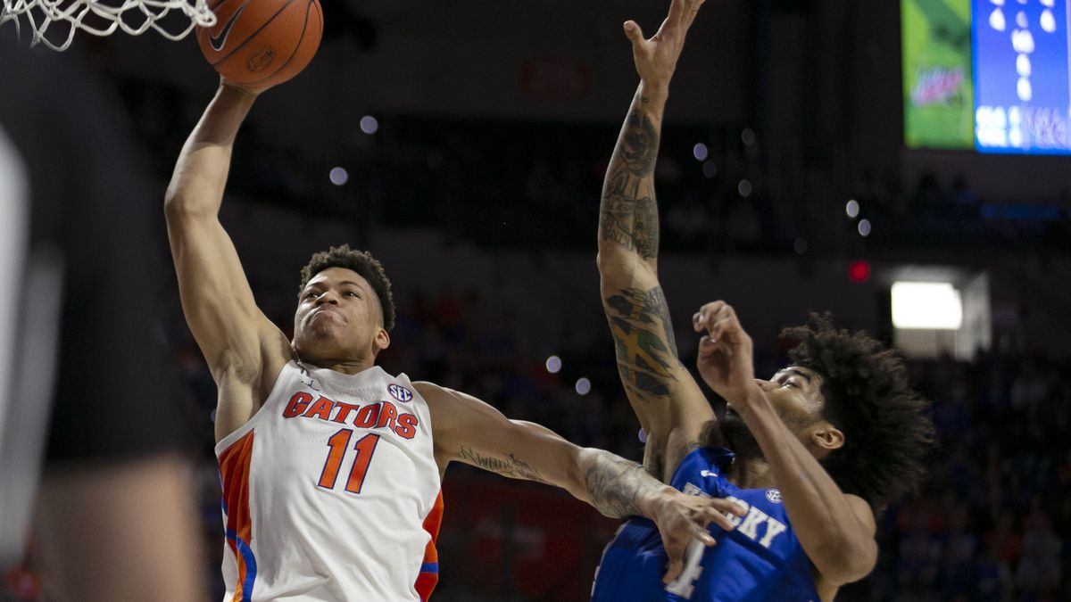Florida forward Keyontae Johnson (11) goes for the dunk against Kentucky forward Nick Richards...