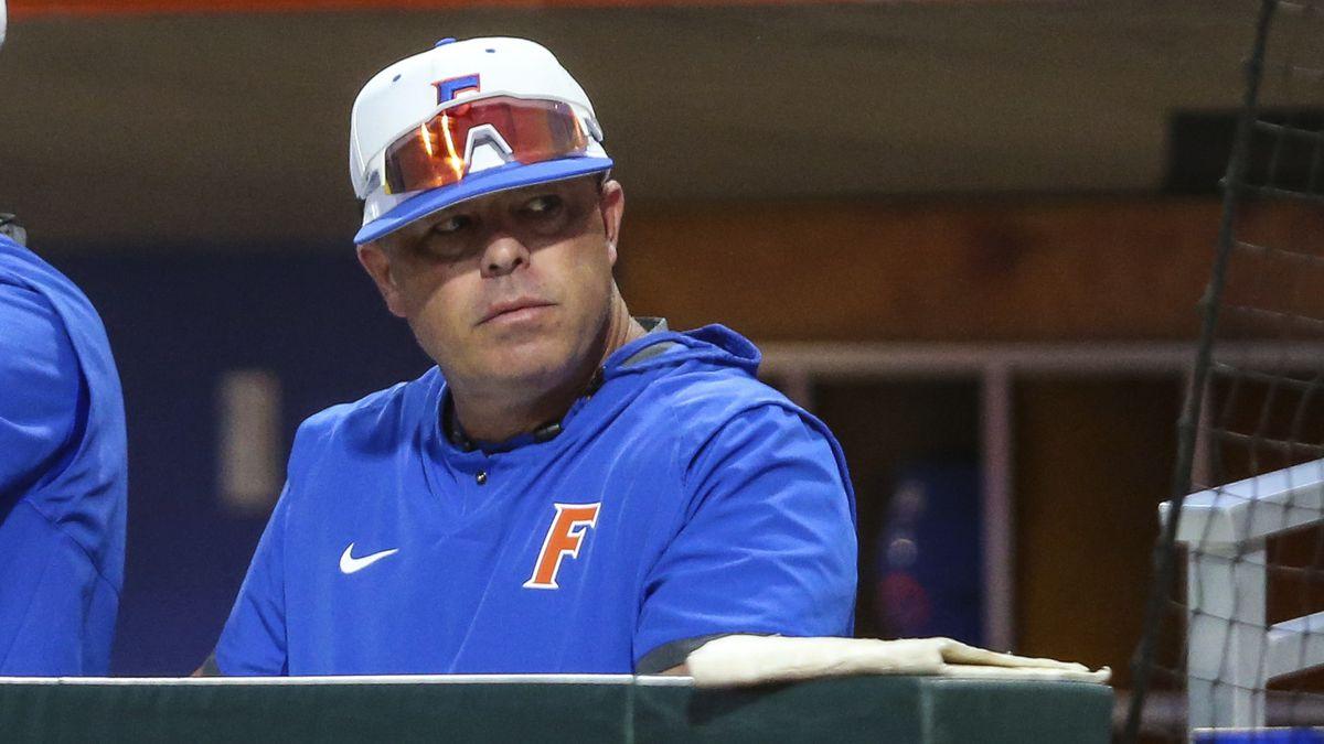 Florida coach Kevin O'Sullivan watches the team's NCAA college baseball game against Florida...