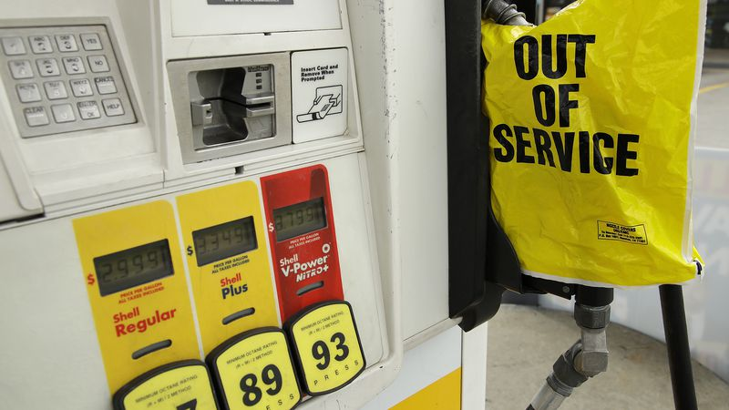 A gasoline station that ran out of gas for sale displays an out of service sign on the pump on...