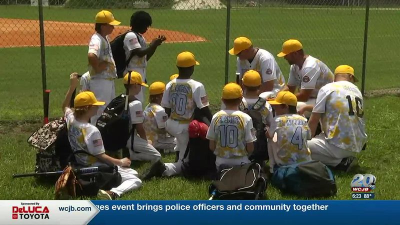 One of the 47 teams competing in the Babe Ruth State Small League Tournament huddles together...