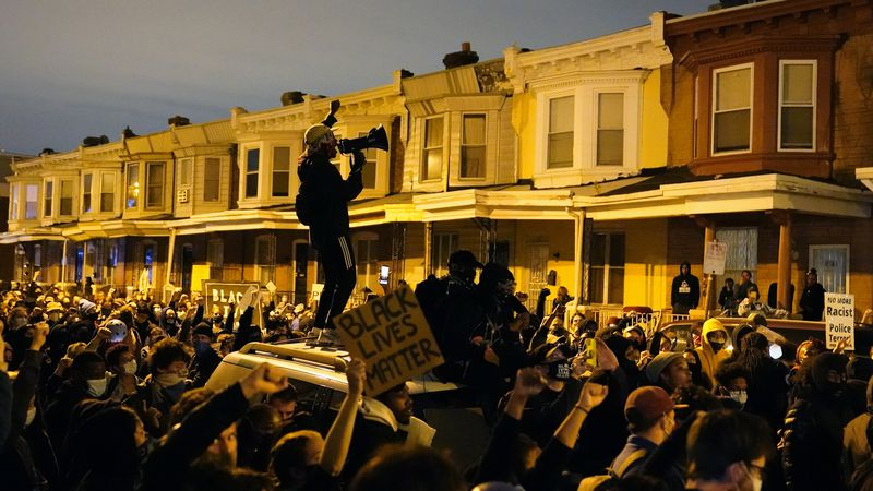 Protesters confront police during a march Tuesday Oct. 27, 2020 in Philadelphia. Hundreds of...