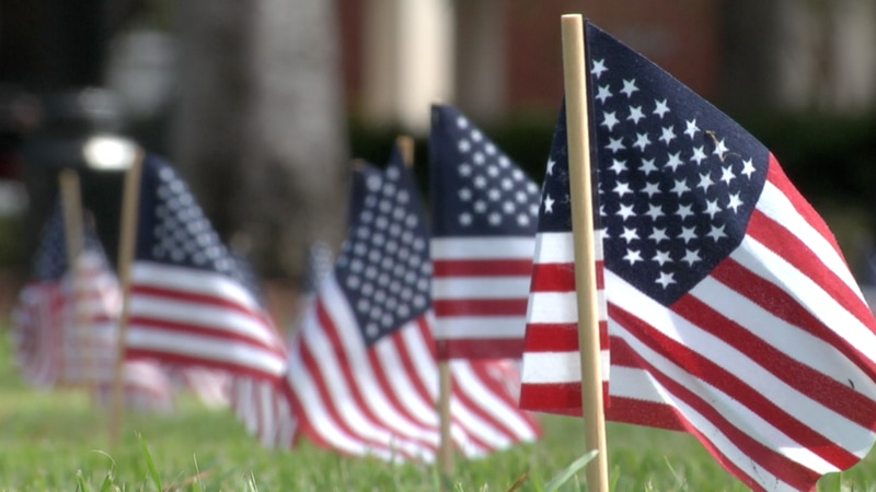The group set up 2,977 flags across the Plaza of the Americas to honor each of the lives that...