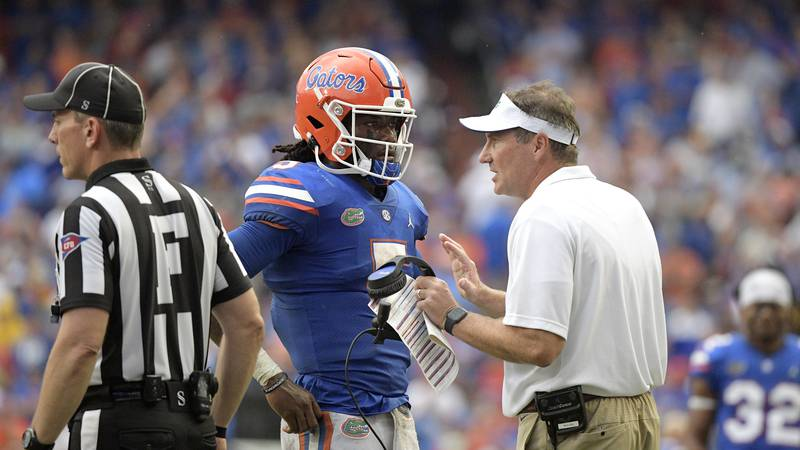 Florida head coach Dan Mullen, right, talks with quarterback Emory Jones (5) after a failed...