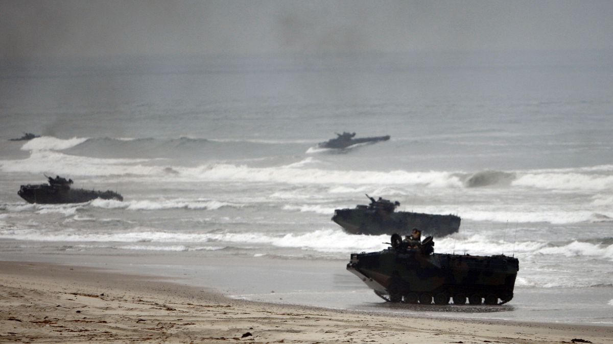FILE - In this Friday, June 2, 2010 file photo, amphibious assault vehicles storm Red Beach...