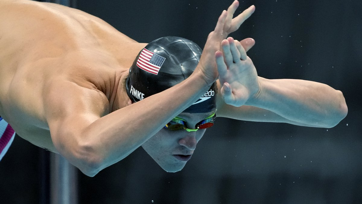 Robert Finke of the United States starts in the men's 800-meters freestyle final at the 2020...