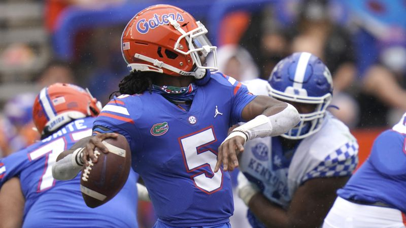 Florida quarterback Emory Jones (5) throws a pass during the second half of an NCAA college...