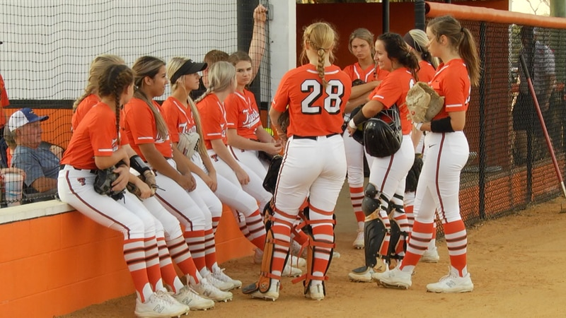 The Trenton Softball team huddles together before their game against Suwannee Thursday night.