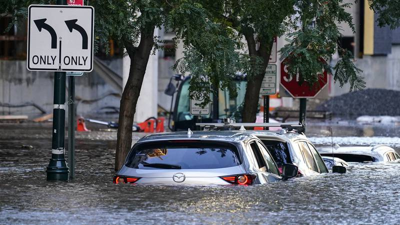 Vehicles are under water during flooding in Philadelphia, Thursday, Sept. 2, 2021 in the...