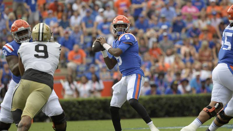 Florida quarterback Emory Jones (5) throws a pass during the first half of an NCAA college...