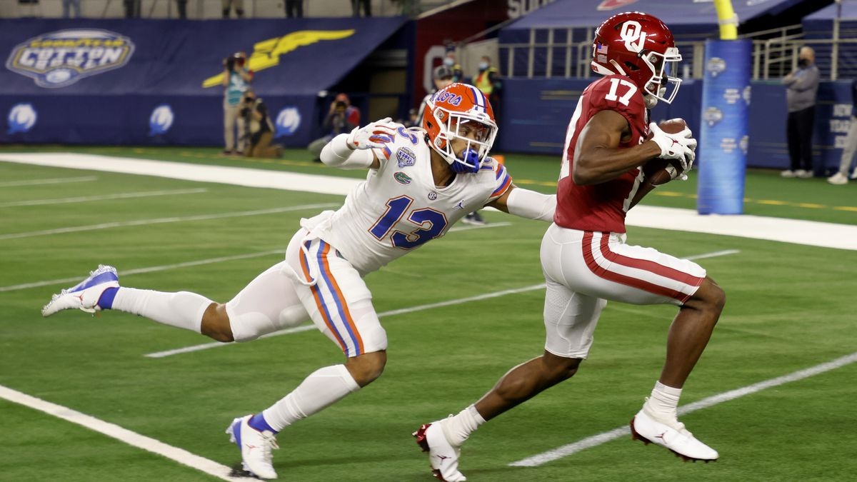 Florida defensive back Donovan Stiner (13) is unable to stop Oklahoma wide receiver Marvin Mims...
