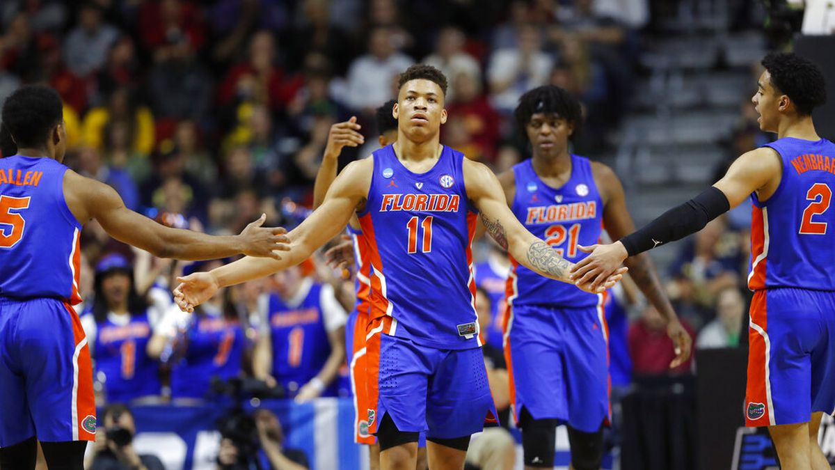 Florida forward Keyontae Johnson (11) celebrates with teammates after making a basket during a...