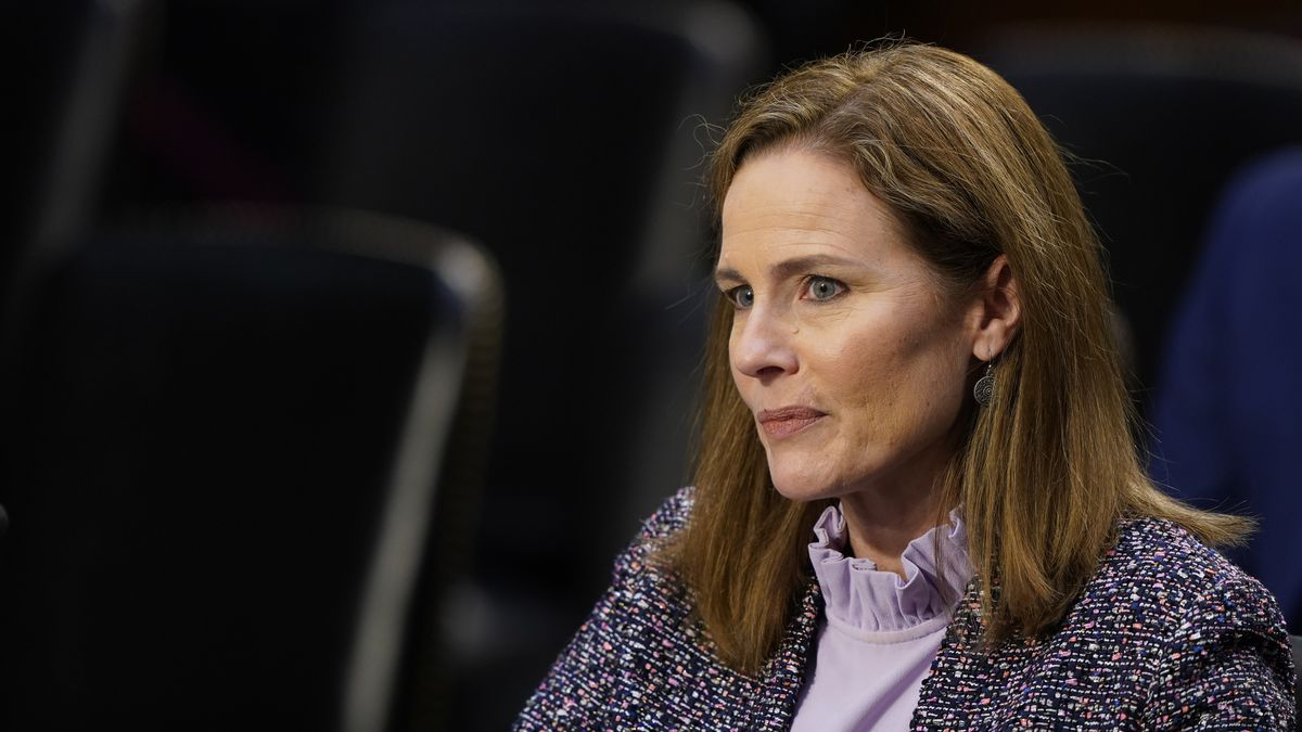 Supreme Court nominee Amy Coney Barrett listens during a confirmation hearing before the Senate...