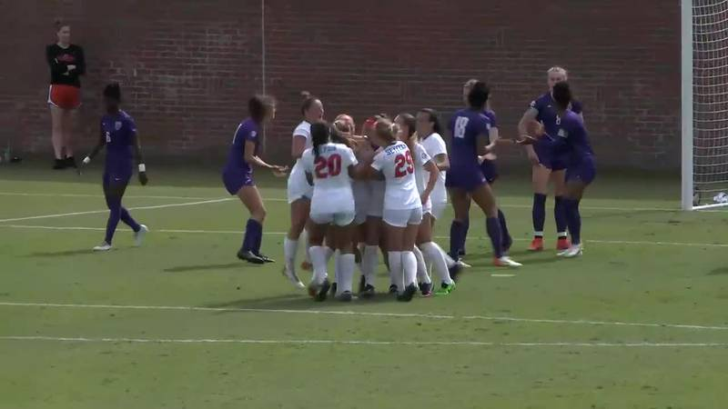 Florida teammates celebrate after Madison Young scores the third goal of the match in the...