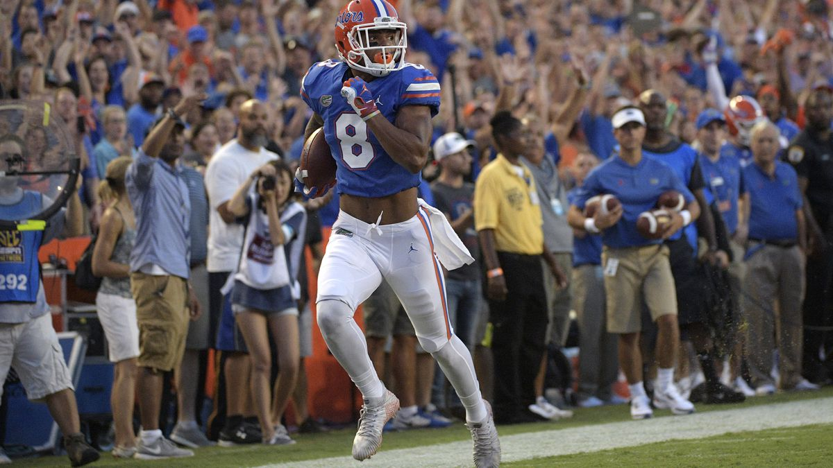 Florida wide receiver Trevon Grimes (8) runs to the end zone after catching a pass for a 34-yard touchdown during the first half of an NCAA college football game against Charleston Southern Saturday, Sept. 1, 2018, in Gainesville, Fla. (AP Photo/Phelan M. Ebenhack)