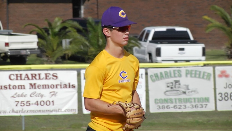 Columbia High School Captain and shortstop Mason Gray prepares to field ground balls at practice.