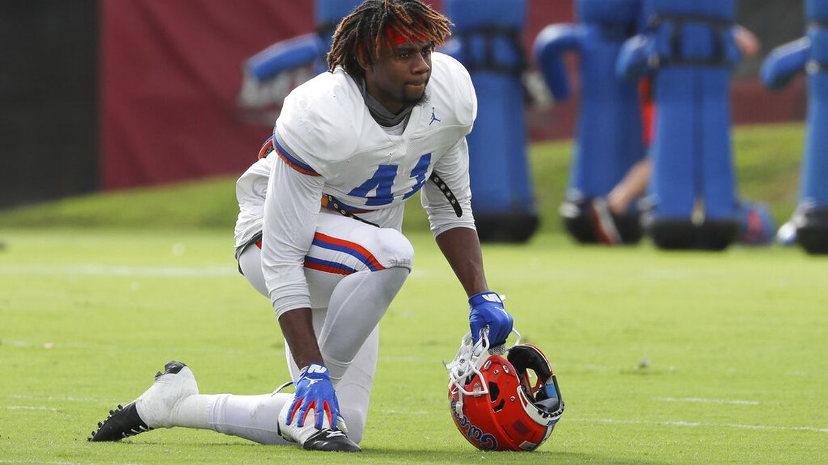 Florida Gators linebacker James Houston IV (41) rests on the field during an NCAA college...