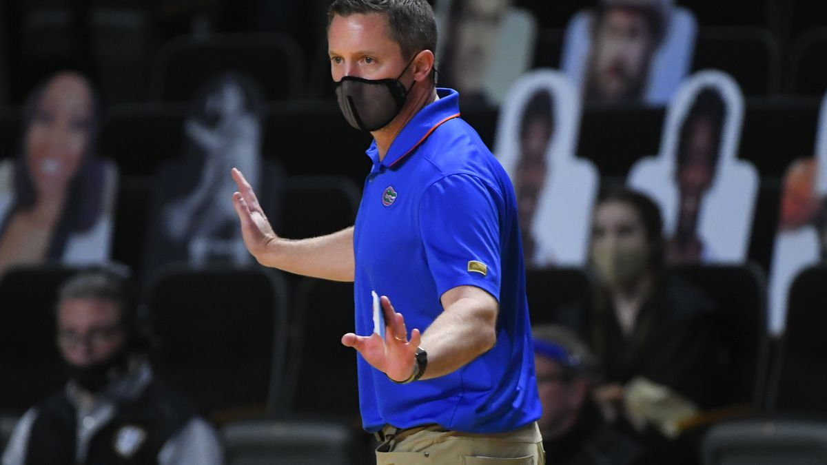 Florida head coach Mike White works the sideline during an NCAA college basketball game against...