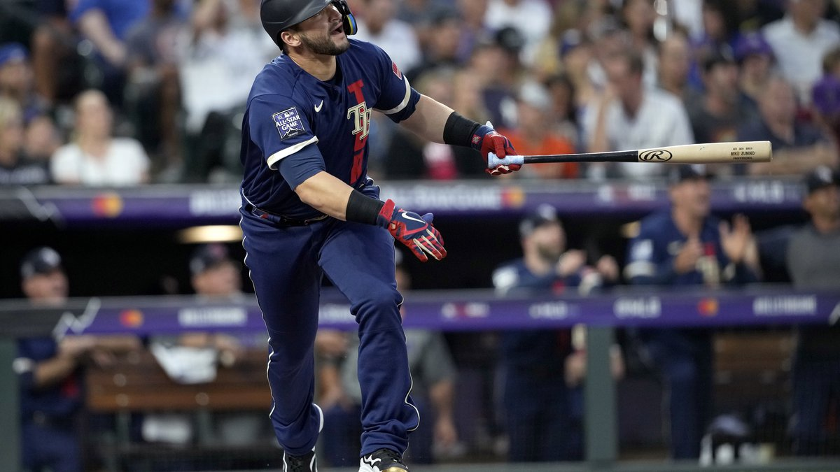 American League's Mike Zunino, of the Tampa Bay Rays, watches his solo home run leave the park...