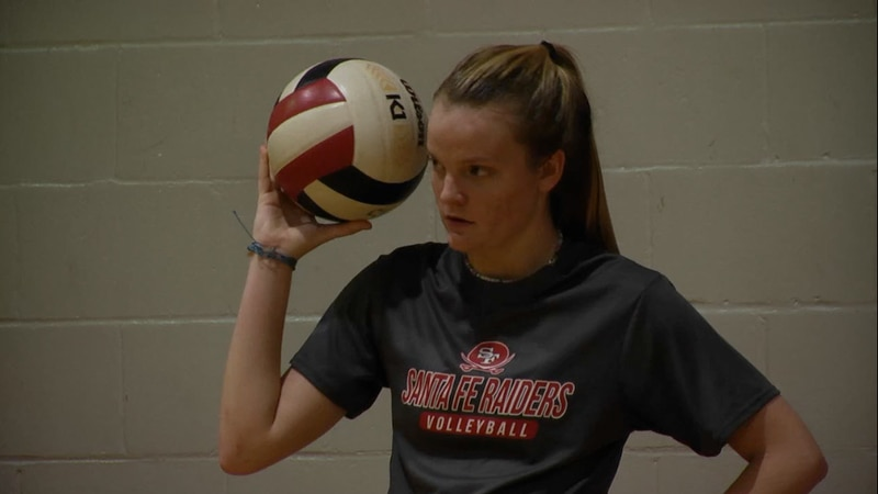 Santa Fe High School's Rylie Tam holds a volleyball at practice.