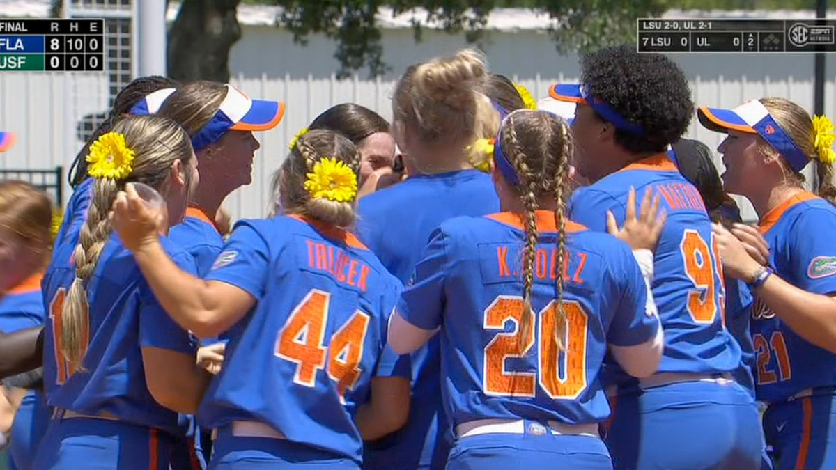 Gator Softball mobs Elizabeth Hightower after the Florida pitcher threw the first no-hitter for...