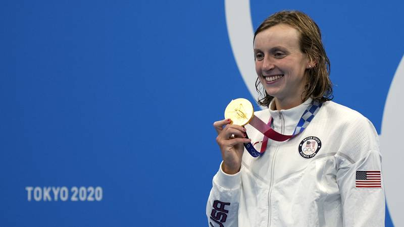 Katie Ledecky of the United States poses with her gold medal after winning the women's...