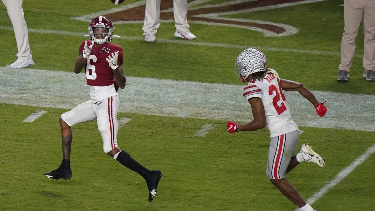 Alabama wide receiver DeVonta Smith catches a touchdown pass in front of Ohio State cornerback...