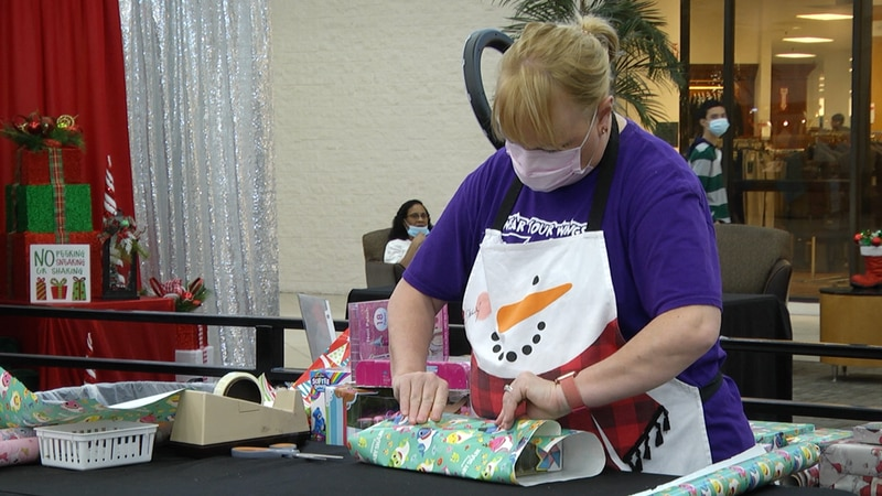 The holiday gift wrapping charity event, helps the Family Violence Prevention Work Group under...