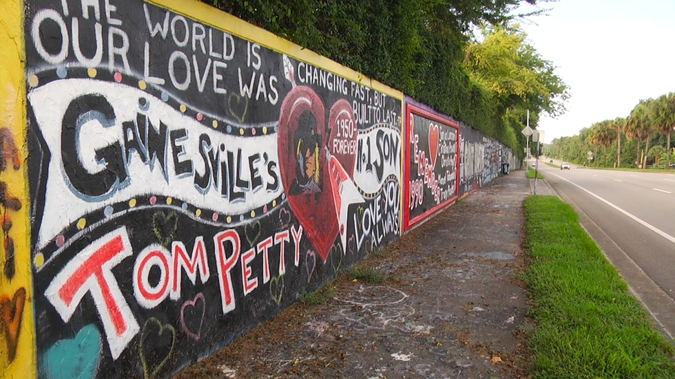 A local artist honors the legendary musician on the 34st wall.