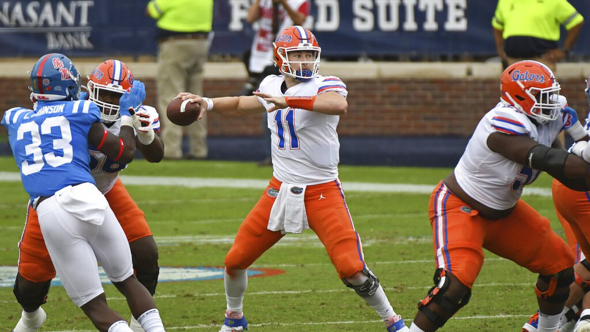 Florida quarterback Kyle Trask (11) releases a pass during the first half of an NCAA college football game against Mississippi in Oxford, Miss., Saturday, Sept. 26, 2020. (AP Photo/Thomas Graning)